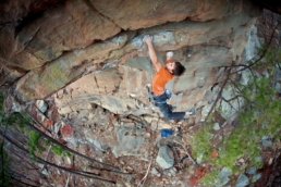 Joe Larson sport climbs on the Cave Creek cliffline in Arkansas.